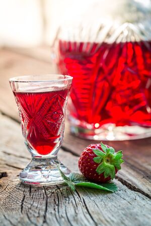 liqueurs: Homemade liqueur with alcohol and strawberries