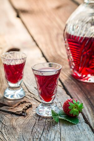 liqueurs: Fresh liqueur with alcohol and strawberries Stock Photo