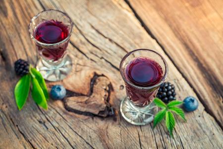 liqueur: Homemade liqueur with alcohol and berry fruits Stock Photo