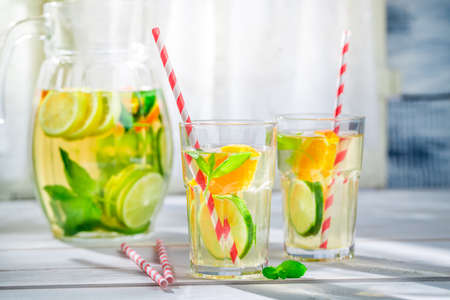 alcoholic beverage: Fresh lemonade with fruits with in sunny day Stock Photo