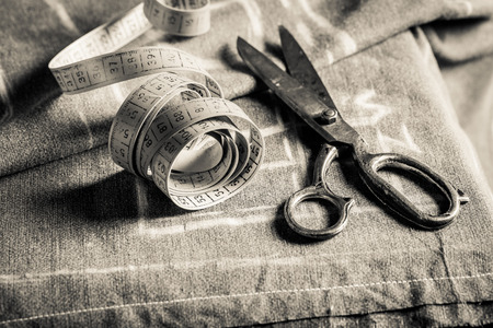 Closeup of sewing table with scissors and cloth