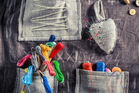 bespoke: Handmade sewing cloth with scissors, needles and threads in tailor workshop Stock Photo
