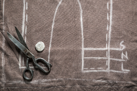 tailor suit: Vintage tailor pattern trousers with cloth, scissors and chalk