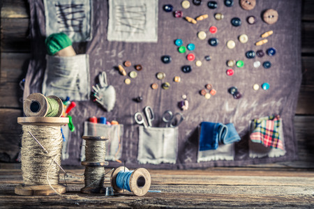 tailor tape: Background made of needles, threads and buttons in tailor workshop Stock Photo