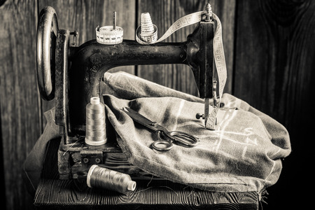 made to measure: Tailor machine with threads, scissors and cloth