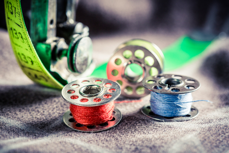 tailor tape: Vintage tailor machine with tailor tape, needle and threads Stock Photo