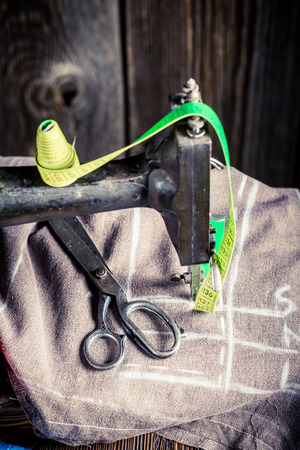 tailor tape: Sewing machine with tailor tape, needle and threads Stock Photo