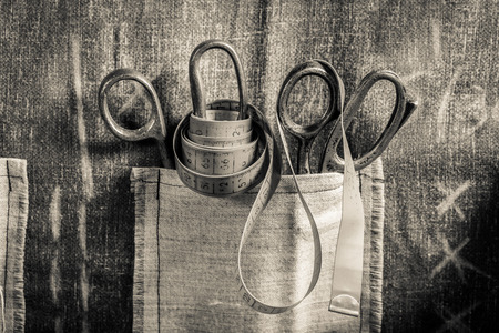 tailor tape: Old scissors and tailor tape Stock Photo