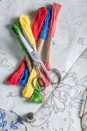 embroidered: Old embroidered napkins made of colored threads Stock Photo