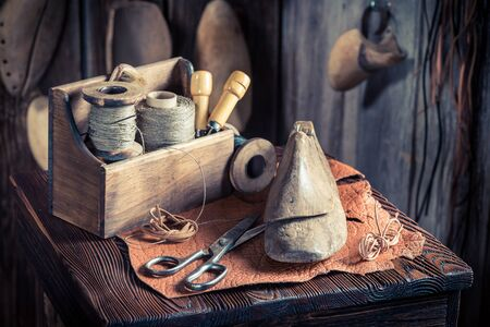 cobbler: Small cobbler workplace with tools, leather and shoes