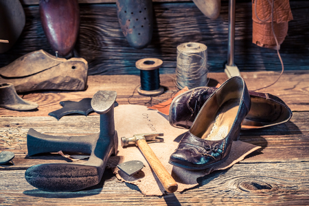 cobbler: Cobbler workshop with tools, leather and shoes