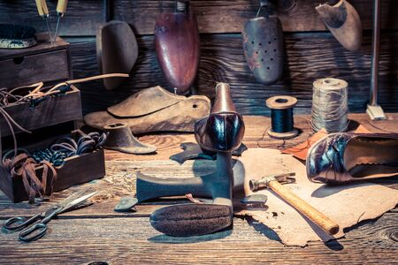 cobbler: Cobbler workplace with tools, shoes and laces Stock Photo