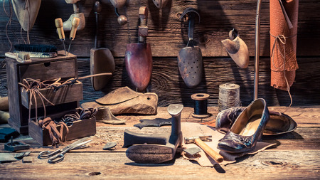 Cobbler workshop with shoes, laces and tools