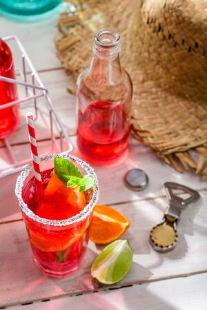 Cold summer drink with citrus fruit