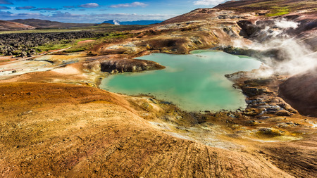 fumarole: Blue pond and volcanic mountain, Iceland Stock Photo