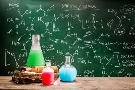fumes: School laboratory with books and beakers Stock Photo