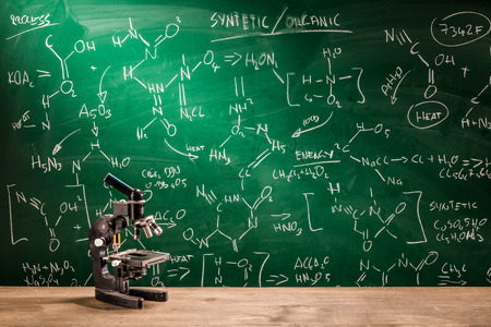 fume: Microscope, blackboard with chemical formulas Stock Photo