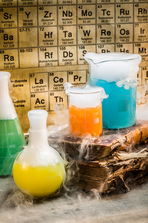 chemical reaction: Old book and chemical reaction in the laboratory Stock Photo