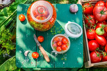 pickling: Table full of ingredients for pickling tomatoes