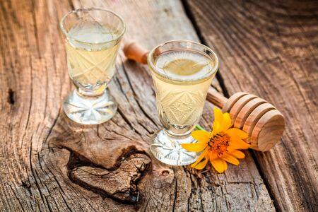liqueur: Delicious homemade liqueur made of alcohol and honey Stock Photo
