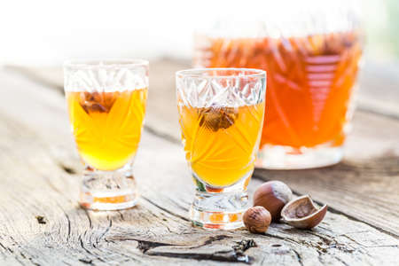 liqueur: Tasty liqueur made of alcohol and nuts Stock Photo