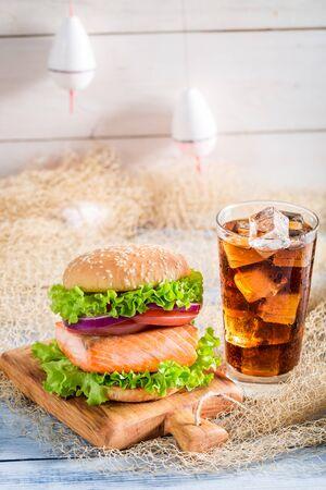 salmon fishery: Fresh burger with fish made by fishermen on fishing net