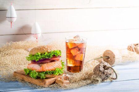 salmon fishery: Closeup of big fishburger with salmon on fishing net Stock Photo
