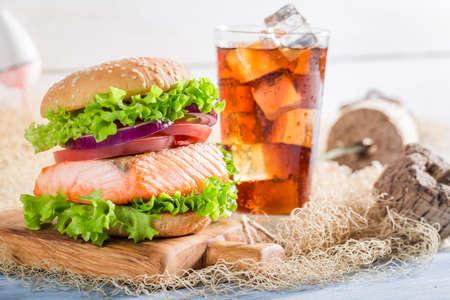 salmon fishery: Fresh fishburger with big salmon on fishing net