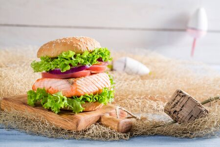 salmon fishery: Homemade sandwich with fish and vegetables on fishing net Stock Photo
