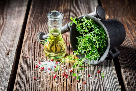 salt and pepper: Mortar with salt, pepper and thyme