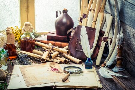 medieval medicine: Old witcher labolatory with scrolls and ingredients