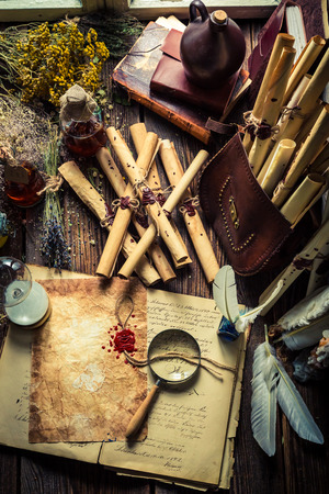 medieval medicine: Scribe and witcher workshop with scrolls and ingredients