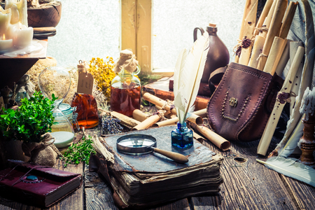 Vintage witcher labolatory with scrolls and ingredients