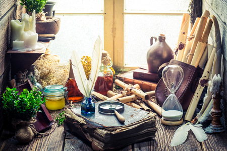 Unique witch workshop full of scrolls and recipe 스톡 콘텐츠