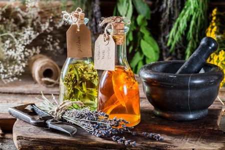 witchdoctor: Tincture with herbs in bottles as an homemade cure
