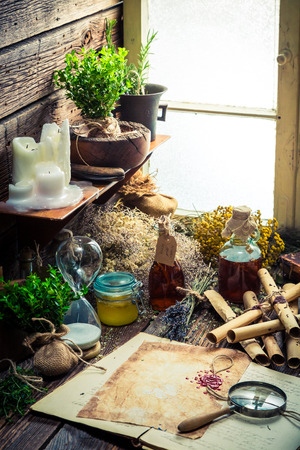 medieval medicine: Old witch workshop with scrolls and ingredients
