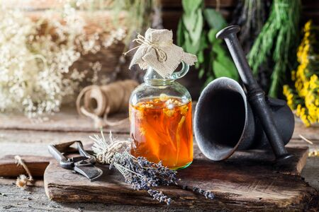 witchdoctor: Medicine in bottles made of honey and fresh herbs Stock Photo