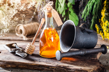 witchdoctor: Therapeutic tincture in bottles made of honey Stock Photo