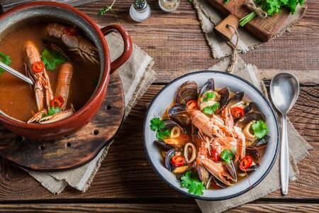 seafood soup: Seafood soup with mussels and langoustines Stock Photo