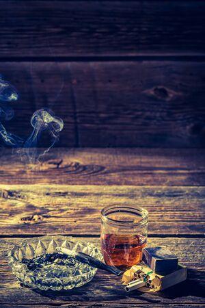 ashtray: Vintage whiskey, cigarettes and ashtray Stock Photo