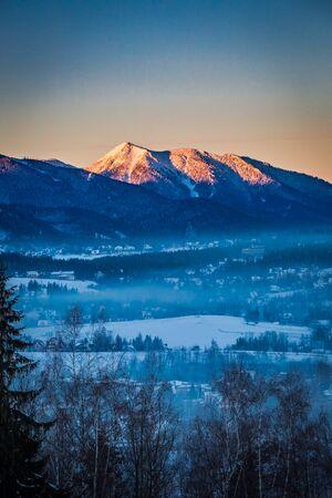 december sunrise: Sunrise in Zakopane with illuminated peak in winter, Tatra Mountains, Poland Stock Photo