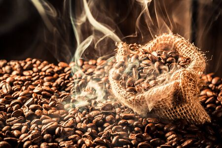 Attar: Coffee bag full of fragrance seeds Stock Photo