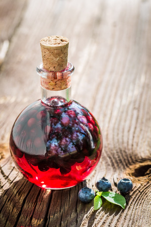witchdoctor: Homemade liqueur in a bottle with alcohol and blueberries