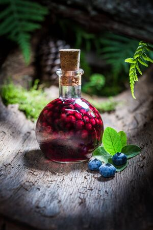 liqueur bottle: Sweet liqueur in a bottle with alcohol and blueberries