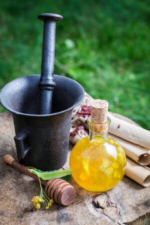 witchdoctor: Healthy and homemade liqueur with alcohol, honey and linden Stock Photo