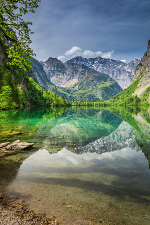 Mirror reflection of the Alps in green Obersee lake, Germany Stock Photo