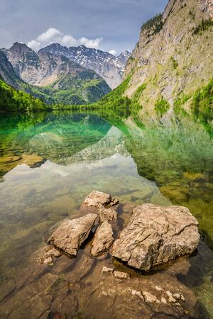 Rocky shore of Obersee lake in Alps, Germany Stock Photo