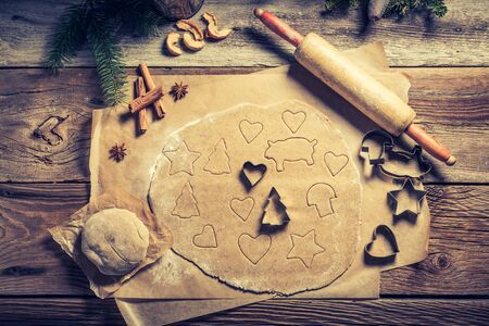 Preparation for baking Christmas cookies on wooden table