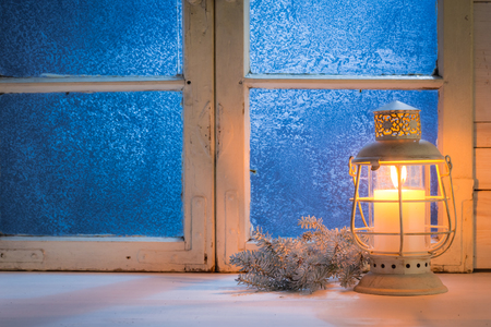frosted window: Frosted window with candle for Christmas