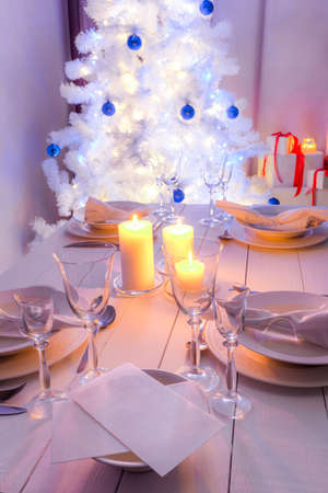 Christmas table setting with blue and white decoration